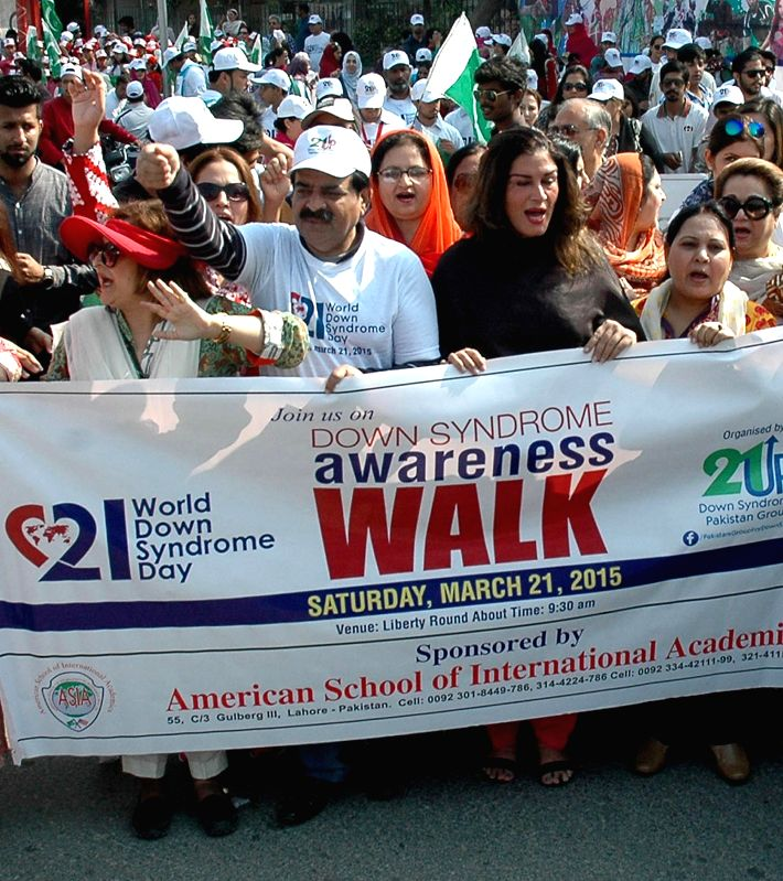 Pakistani people attend a rally to mark World Down Syndrome Day in eastern Pakistan's Lahore, March 21, 2015. World Down Syndrome Day is observed to raise public ...
