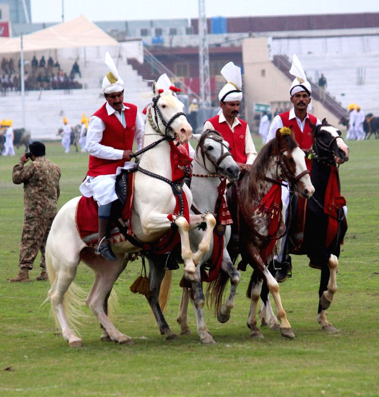 Horse riders arrive for tent pegging competition during Horse and Cattle Show in eastern Pakistan's Lahore on March 6, 2015. After a gap of 11 years, the city of ...