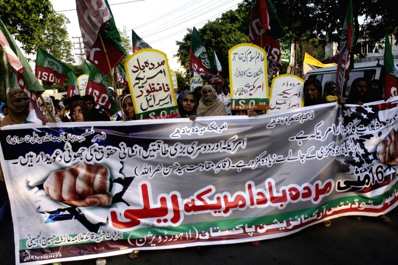 "Pakistani protesters hold placards during a protest, marking the 66th anniversary of what the Palestinians call the ""Nakba"" or ""catastrophe"", ..."