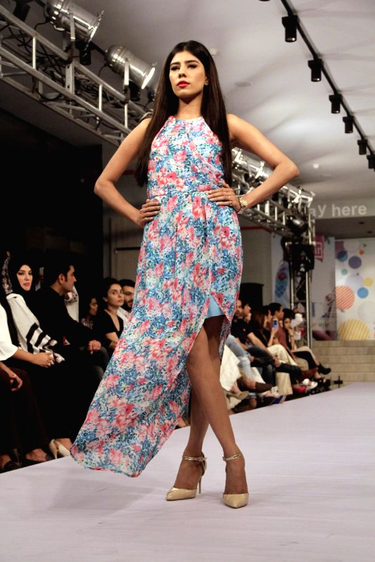 A model presents a creation by designer Warda during a fashion show in eastern Pakistan's Lahore on May 2, 2015.