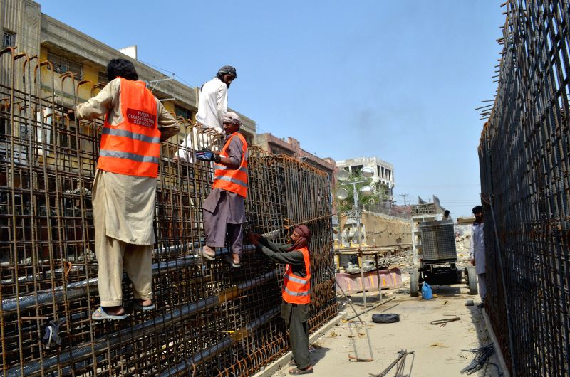 LAHORE, May 2, 2017 - Pakistani laborers work at the construction site of Orange Line Train system on International Labor Day in eastern Pakistan's Lahore May 1, 2017. The Orange Line will be ...