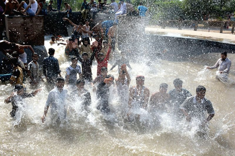 LAHORE, May 8, 2017 - People cool themselves off in a canal during the heat wave in eastern Pakistan's Lahore, on May 8, 2017. Temperature reached 43 degrees Celsius in Lahore on Monday. ...