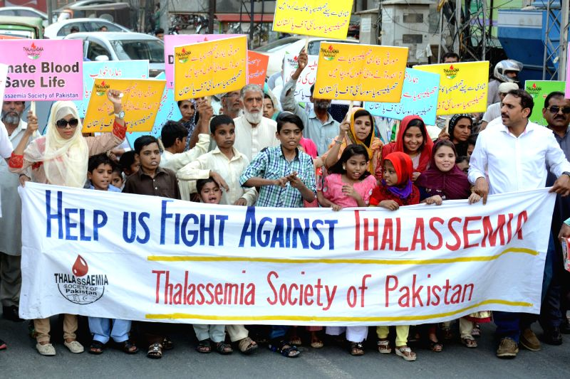 LAHORE, May 8, 2017 - People hold placards during a rally to mark International Thalassemia Day in eastern Pakistan's Lahore, May 8, 2017. Thalassemia is a genetic disease of the blood that patients ...