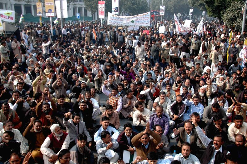 Lahore (Pakistan): Members of the All Pakistan Clerks Association shout slogans against rising inflation in eastern Pakistan's Lahore on Nov. 25, 2014. Hundreds of clerks staged a protest rally in ...