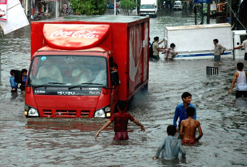 A truck drives into a flooded street after heavy rain in east Pakistan's Lahore on Sept. 1, 2014.