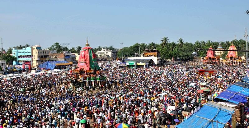 Lakhs of devotees participate in Ulta RathYatra (the return journey of the chariots of Lord Jagannath, Lord Balabhadra and Devi Subhadra) organised in Puri of Odisha on July 7, 2014.