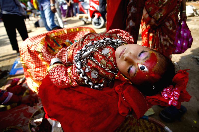 Living Goddess Kumari of Bungmati sleeps during the festival time in Lalitpur, Nepal, April 22, 2015. The Kumari, a young pre-pubescent girl who is a ...