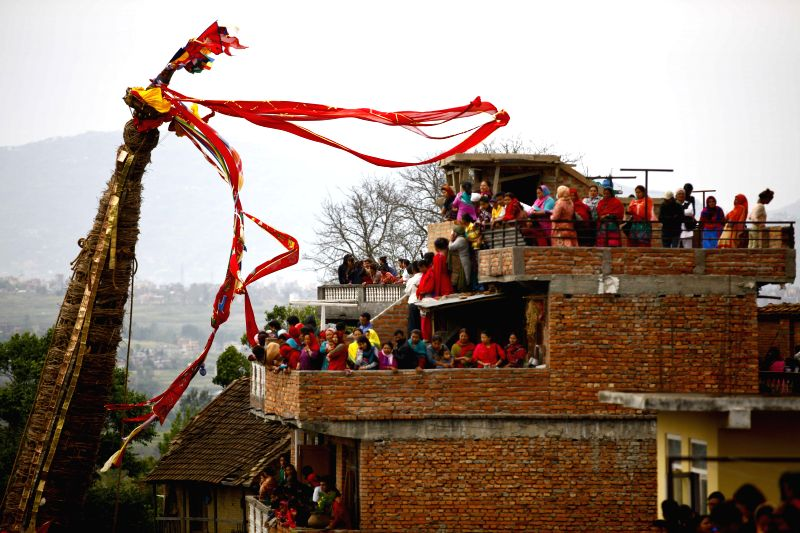 Devotees observe the chariot of Rato Machhendranath during the Rato Machhendranath festival at Bungamati in Lalitpur, Nepal, April 22, 2015. Rato Machhendranath ...