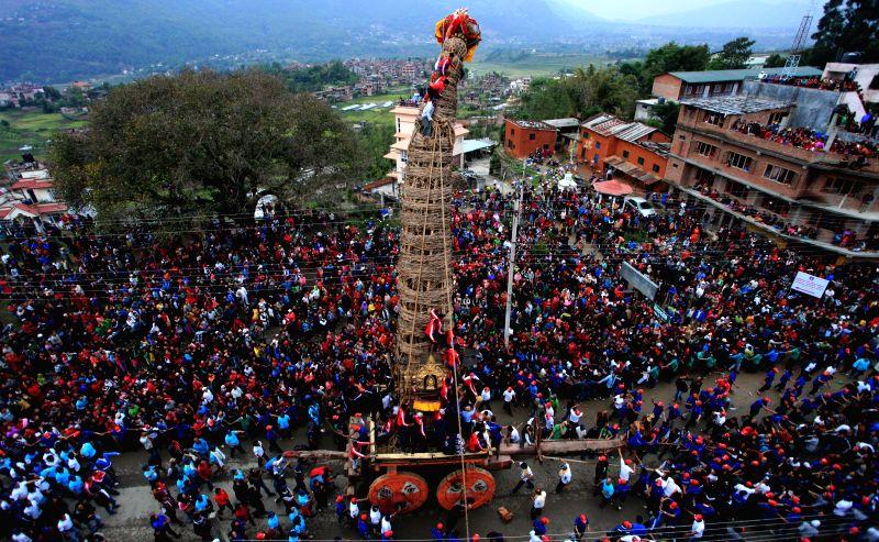 Nepalese devotees pull the chariot of Rato Machhendranath during Rato Machhendranath festival in Bungamati, Lalitpur, Nepal, on April 24, 2015. (Xinhua/Sunil ...