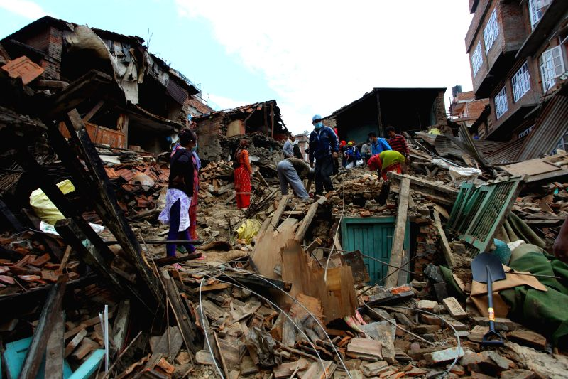 People remove the debris after earthquake in Lalitpur, Nepal, April 29, 2015. The 7.9-magnitude quake hit Nepal at midday on Saturday.