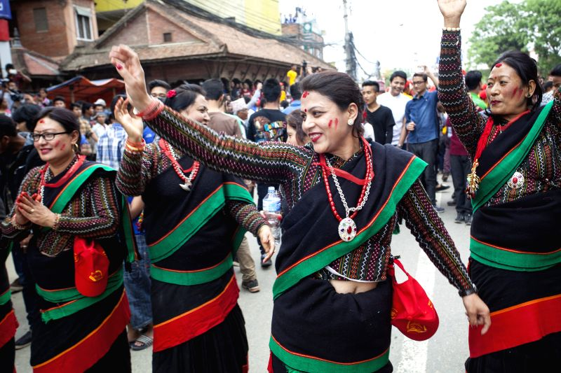 LALITPUR, April 30, 2017 - Devotees dance on the first day of Rato Machhindranath festival in Lalitpur, Nepal, April 30, 2017. According to the Hindu legend, Rato Machhindranath is known as the god ...