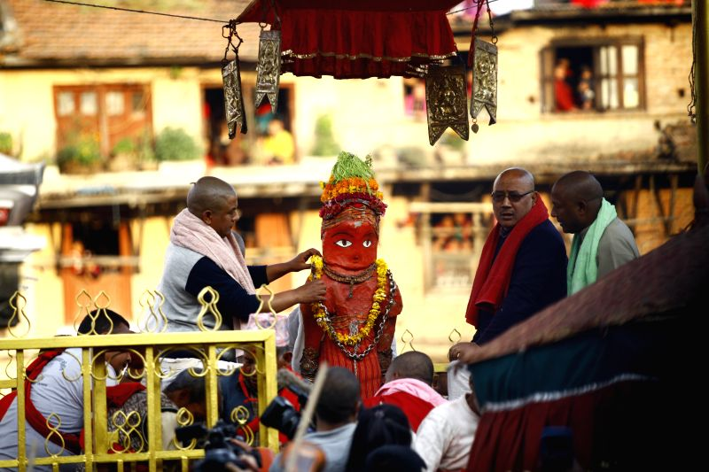 A priest decorates an idol of Rato Machhindranath during the Rato Machhendranath festival at Bungamati, Lalitpur in Nepal, April 5, 2015. Rato Machhindranath is ...