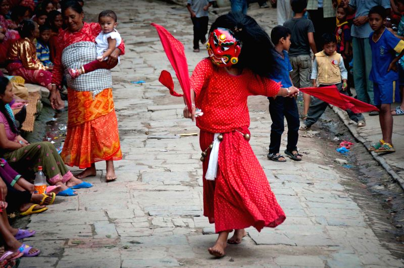 A Newari in traditional costume performs Lakhey dance at Khokana in Lalitpur, Nepal, Aug. 12, 2014. The Lakhey dance is performed mainly at the second day of ...