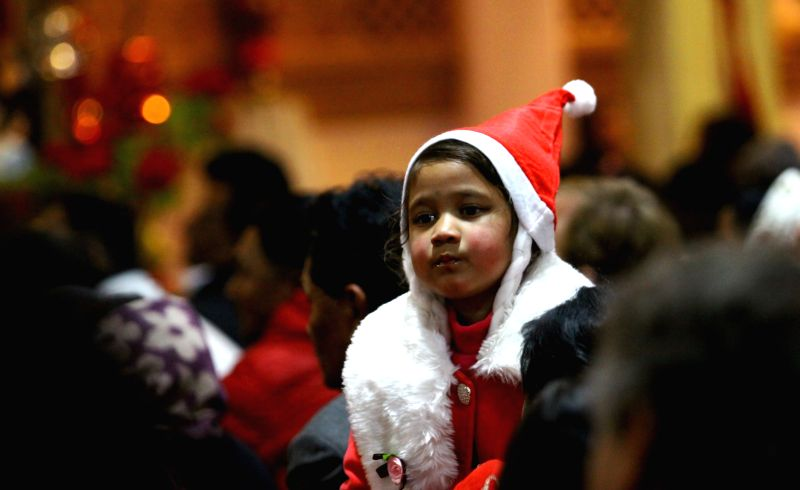 A girl attends a prayer on the eve of Christmas at Assumption Church in Lalitpur, Nepal, Dec. 24,2014.