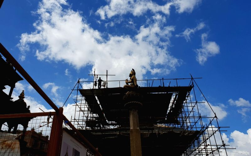 LALITPUR, July 26, 2018 - People work at a reconstruction site of Patan Durbar Square in Lalitpur, Nepal, on July 25, 2018. Reconstruction process is undergoing in Patan Durbar Square as many temples ...