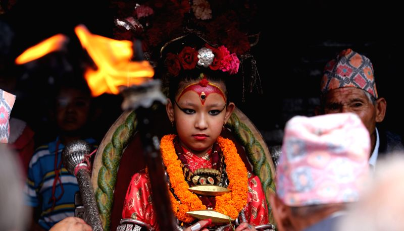 LALITPUR, July 30, 2016 - Living Goddess Kumari reacts on the last day of the Rato Machindranath chariot festival, also known as Bhoto Jatra, in Jawalakhel of Lalitpur, Nepal, July 29, 2016. The ...