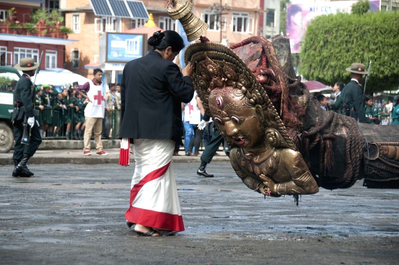 A devotee prays to the god Rato Machindranath during the Bhoto Jatra festival in Jawalakhel of Lalitpur, Nepal, June 22, 2014. According to the Hindu legend, Rato .