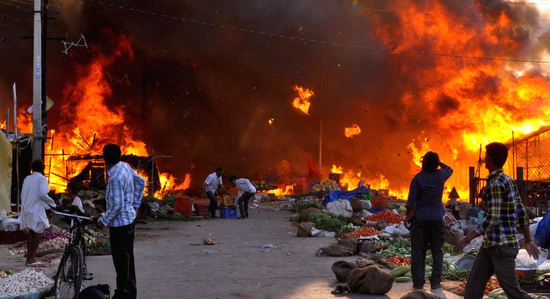 Lalkothi vegetable market in flames following a short circuit in Jaipur on April 29, 2014.