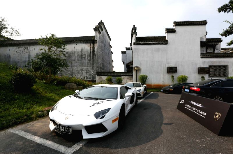 Lamborghini supercars arrive at Huizhou ancient town during a cruise in Huangshan, east China's Anhui Province, July 14, 2015. The cruise is a part of the ...