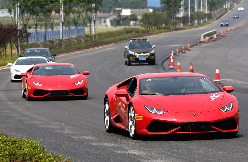 Lamborghini supercars move on a road during a cruise  in Huangshan, east China's Anhui Province, July 14, 2015. The cruise is a part of the Lamborghini China ...