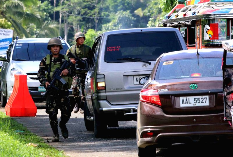 LANAO DEL SUR, May 24, 2017 - Soldiers from the Armed Forces of the Philippines conduct a checkpoint in Lanao Del Sur Province, the Philippines, May 24, 2017. Philippine President Rodrigo Duterte ...
