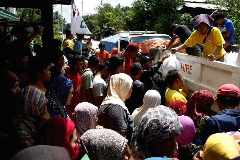 LANAO DEL SUR, May 28, 2017 - Evacuees line up to receive relief goods as clashes between the government troops and militant Maute group continue in Lanao Del Sur Province, the Philippines, May 28, ...