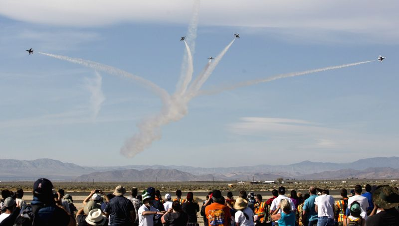 People watch the U.S. Air Force Thunderbirds perform during the Los Angeles County Air Show at William J Fox Airport in Lancaster, California, the U.S., on March ...