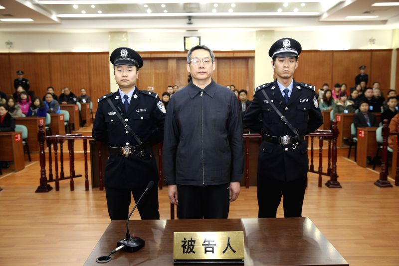 Langfang (China): Liu Tienan (C), a former senior economic planning official, stands trial at the Langfang Intermediate People's Court in Langfang, north China's Hebei Province, Dec. 10, 2014. Liu ...
