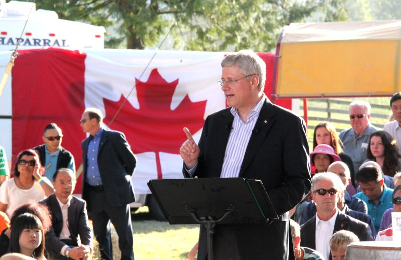 LANGLEY(CANADA), Aug. 21, 2014 Canadian Prime Minister Stephen Harper(C) delivers a speech during his stopover in Langley in western province of British Columbia on his way to the North ..