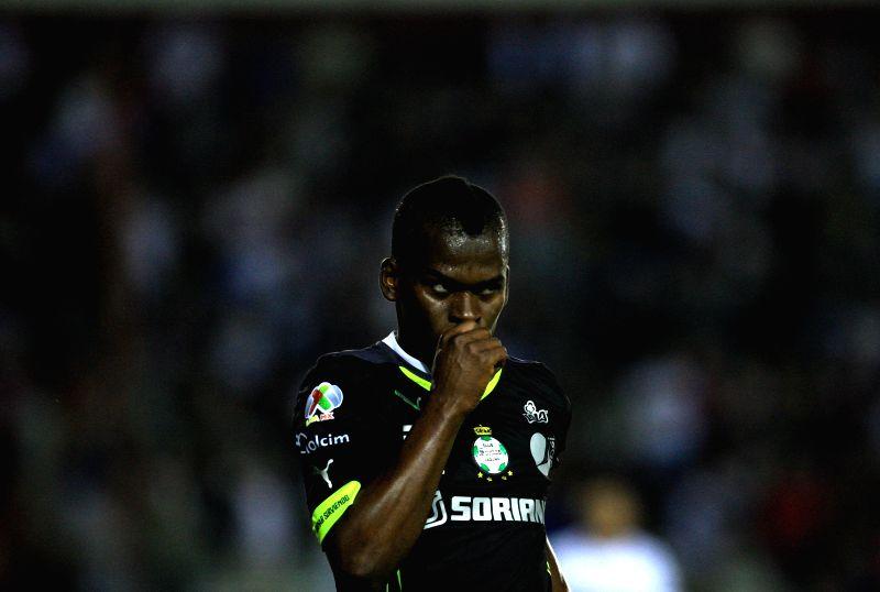 Santos' Darwin Quintero celebrates after scoring during the first leg of the eight-finals of the 2014 Libertadores Cup against Lanus at Ciudad de Lanus Stadium in ...