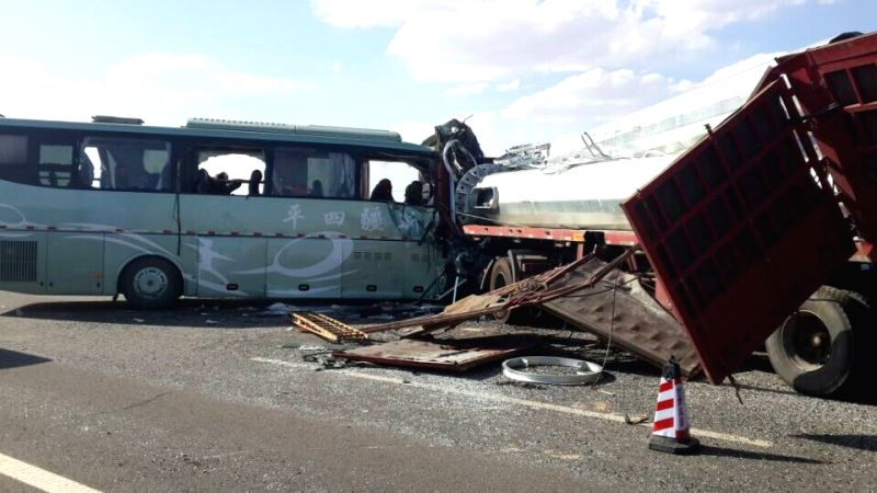 Photo taken on Aug. 26, 2014 shows a bus collided head-on with a truck on a highway in Guazhou County in the city of Jiuquan, northwest China's Gansu Province. ...