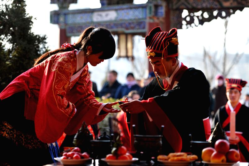 People wearing Han Chinese clothing, the national costume of Han people in China, attend a sacrificial rite ahead of the winter solstice day, or the Dongzhi ...