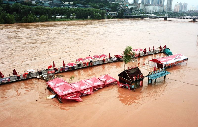 LANZHOU, July 24, 2018 - Photo taken on July 23, 2018 shows a submerged dock in Lanzhou section of the Yellow River, northwest China's Gansu Province. The Yellow River Flood Control and Drought ...