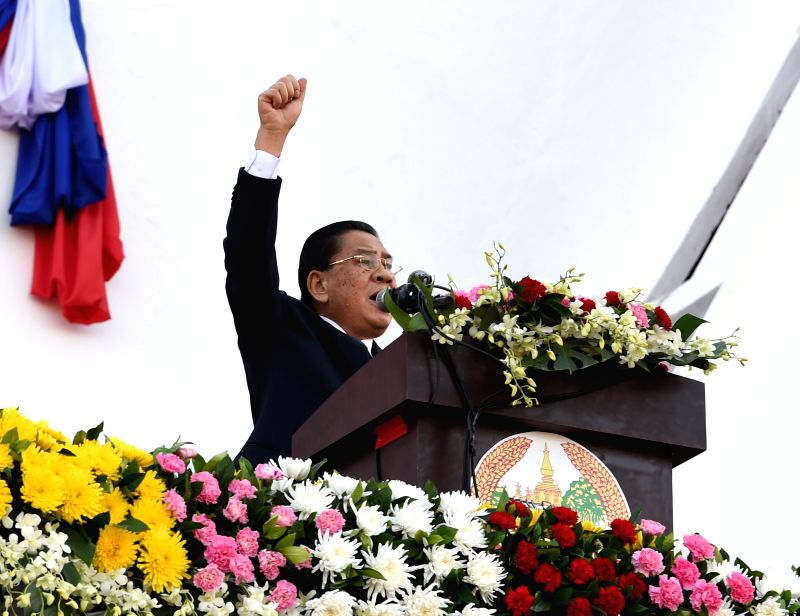 Lao President Choummaly Sayasone, who is also the general secretary of the Central Committee of the Lao People's Revolutionary Party (LPRP), delivers a speech ...