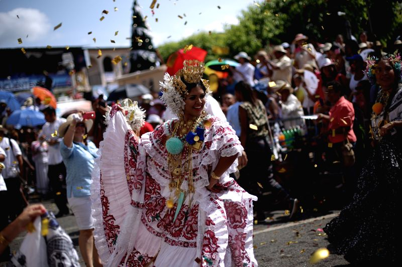 """A woman wearing the traditional dress of """"La Pollera"""" takes part in the """"Parade of the Thousand Polleras"""", in Las Tablas city, Los Santos ..."""