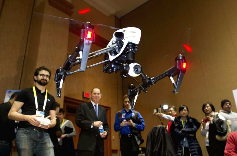 Representatives from Chinese DJI company show Inspire 1 quadcopter during the preview media show of The Consumer Electronics Show (CES) in Las Vegas, the United ...