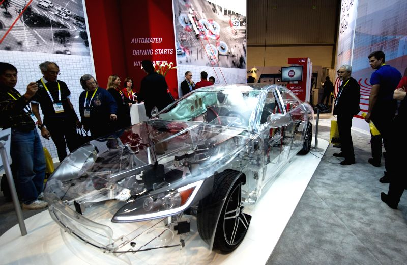 A transparent TRW model car is seen during the 2015 International Consumer Electronics Show (CES) in Las Vegas, the United States, on Jan. 6, 2015. (Xinhua/Yang ...