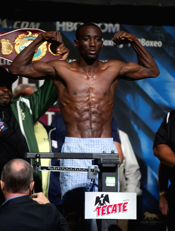 LAS VEGAS, July 23, 2016 - Terence Crawford of the United States steps on the scale during the vacant junior welterweight title weigh-in at the MGM Grand Garden Arena in Las Vegas, the United States, ...