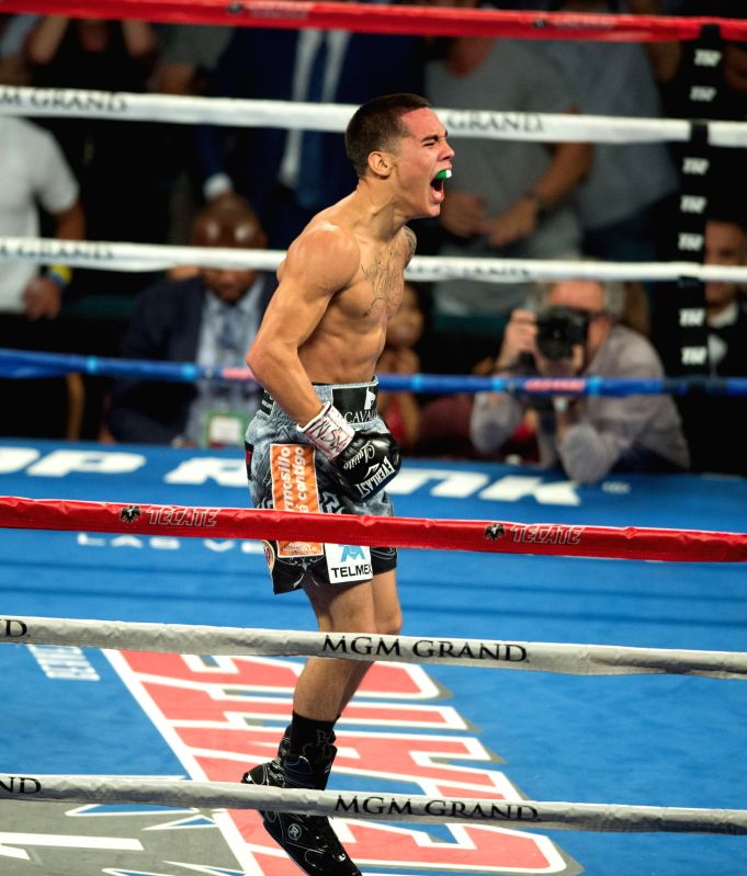 LAS VEGAS, July 24, 2016 - Oscar Valdez Jr. (C) of Mexica celebrates after defeating Matias Rueda of Argentina during the vacant WBO featherweight title boxing match in Las Vegas, the United States, ...