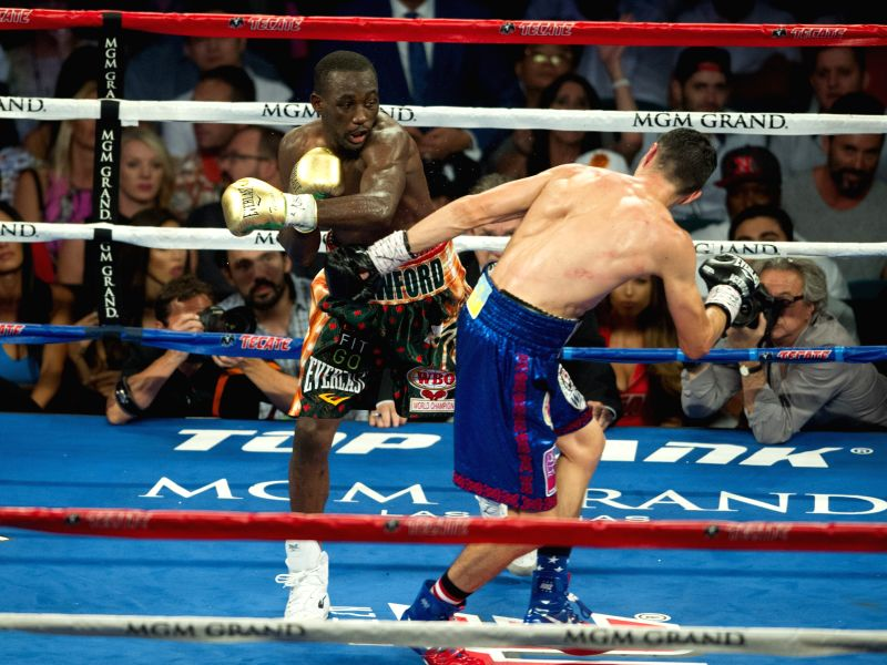 LAS VEGAS, July 24, 2016 - Terence Crawford (L) of the United States fights with Viktor Postol of Ukraine during their WBC-WBO junior welterweight title unification boxing bout in Las Vegas, the ...