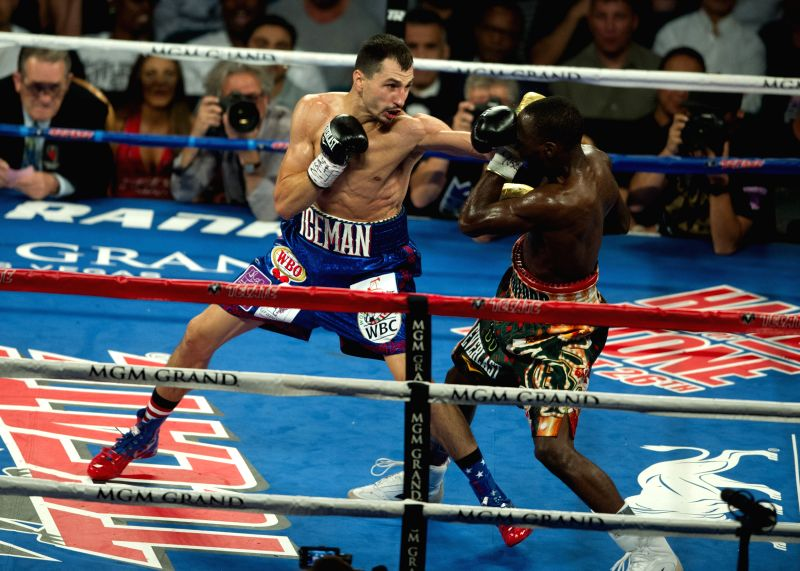 LAS VEGAS, July 24, 2016 - Terence Crawford (R) of the United States fights with Viktor Postol of Ukraine during their WBC-WBO junior welterweight title unification boxing bout in Las Vegas, the ...