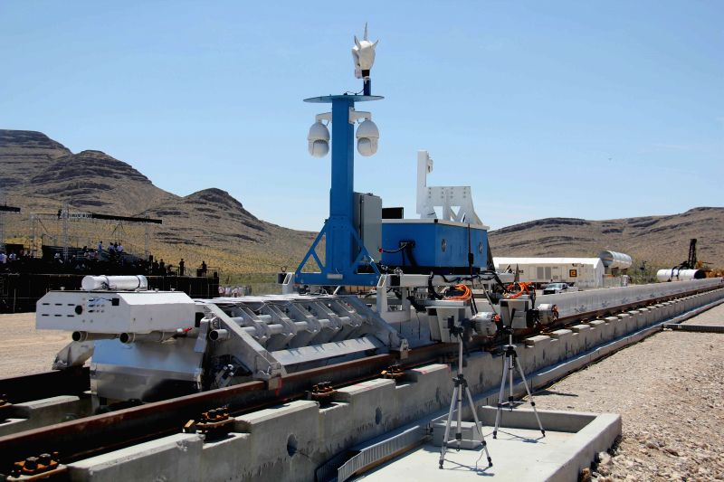 LAS VEGAS, May 12, 2016 - A recovery vehicle and a test sled sit on rails after a propulsion open-air test of Hyperloop One's transportation technology, in Nevada, U.S. May 11, 2016. Hyperloop One ...