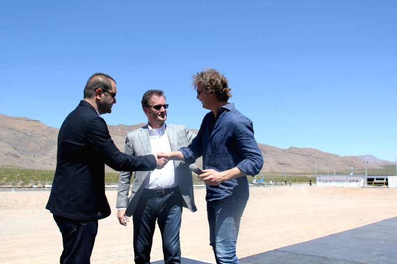 LAS VEGAS, May 12, 2016 - Hyperloop One co-founders Shervin Pishevar (L), Brogan BamBrogan(R) and CEO Rob Lloyd(C) congratulate each other after a propulsion open-air test of Hyperloop One's ...
