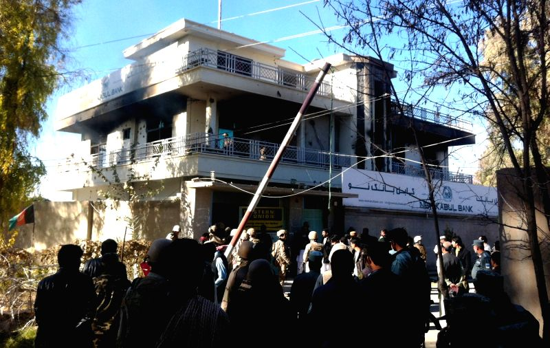 Afghan security personnel investigate the blast site in Lashkar Gah, Helmand province, Afghanistan, Dec. 17, 2014. Some 10 people, including five civilians, ...