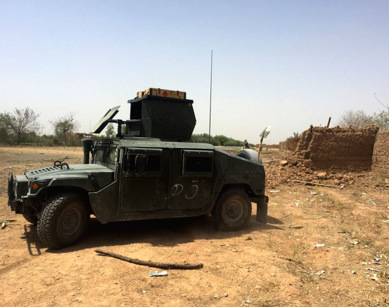 LASHKAR GAH, July 14, 2018 - Photo taken on July 14, 2018 shows the site of a suicide attack in Lashkar Gah city, capital of Helmand province, Afghanistan. At least one police officer was killed and ...