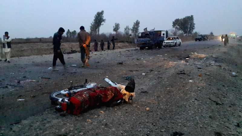 Afghan policemen investigate at the blast site in Lashkar Gah, Afghanistan, March 10, 2015. At least eight people were killed and six others wounded in a ...
