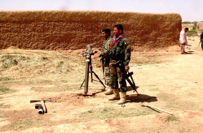 LASHKAR GAH, May 21, 2016 - Afghan army soldiers take part in a military operation in Marjah district of Helmand province, Afghanistan, May 20, 2016. According to an army spokesman, a total of 13 ...