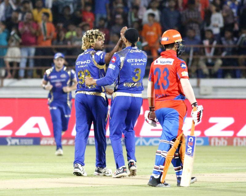 Lasith Malinga of Mumbai Indians celebrates fall of a wicket during an IPL 2017 match between Gujarat Lions and Mumbai Indians at Saurashtra Cricket Association Stadium in Rajkot on April 29, ...