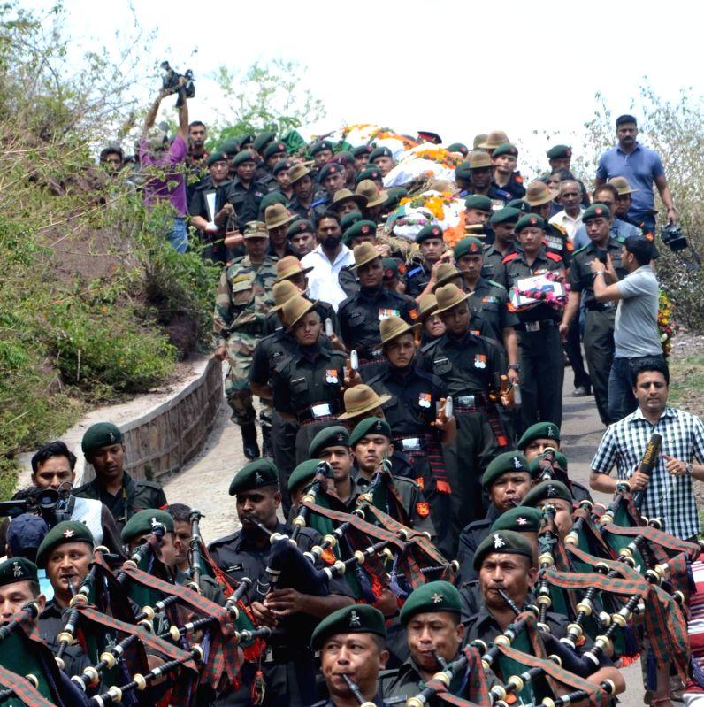 Last rites of Havildars Girish Gurung and Dambar Bahadur and Rifleman Rabin Sharma, who were killed in a gunfight in Nowgam sector of Kashmir's Kupwara district underway at 14 Gorkha Training ... - Rabin Sharma
