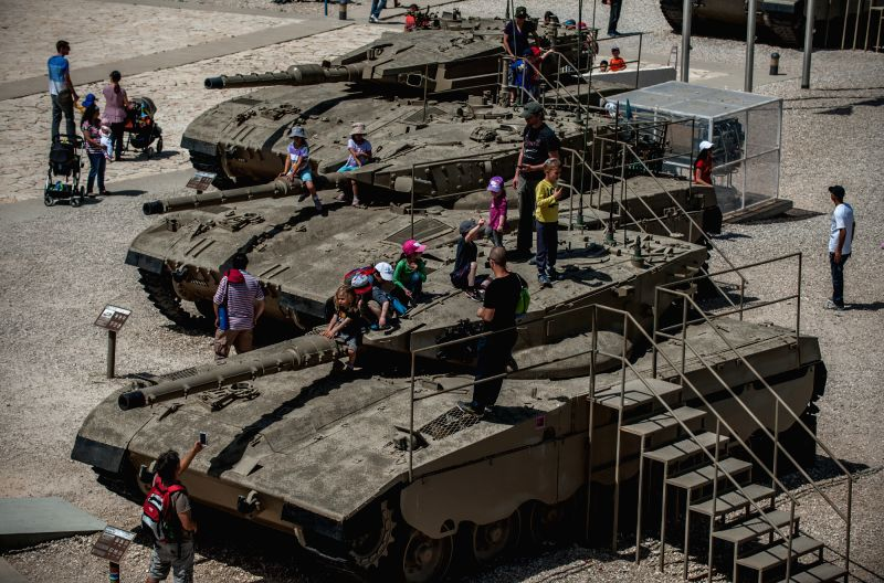 Visitors are seen around a Merkava Main Battle Tank I (Bottom), Merkava Main Battle Tank II (C) and Merkava Main Battle Tank III at Yad La'shiryon Latrun, memorial .